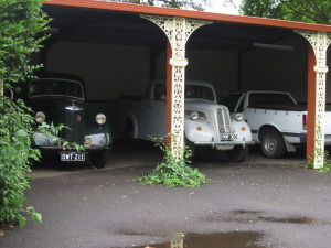 Prefect, Popular and Falcon in their fancy garage at Montville