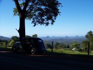 1939 Ford Prefect , at Maleny with Glasshouse Mountains in the Background. Michael vought this car for $40 in 1974 and in 1980 it was our wedding car at Sandgate where we lived